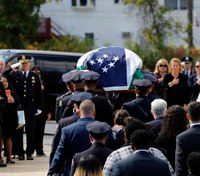 NYPD officer killed by police fire hailed as a hero
