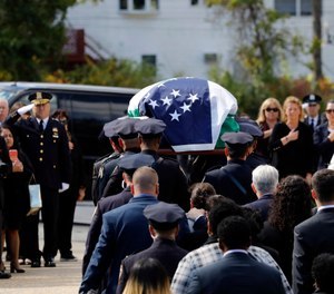 Brian Mulkeen's funeral service was attended by hundreds of officers, as well as New York City Mayor Bill de Blasio. (Photo/AP)