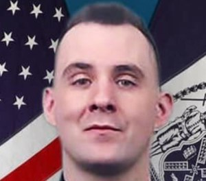 Brian Mulkeen was shot three times by his fellow officers as he grappled on the ground with an armed suspect. (Photo/NYPD)