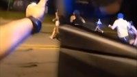Watch: Officers sprint toward gunfire at block party mass shooting
