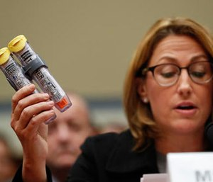 In this Wednesday, Sept. 21, 2016, file photo, Mylan CEO Heather Bresch holds up EpiPens while testifying on Capitol Hill in Washington, before the House Oversight Committee hearing on EpiPen price increases. (AP Photo/Pablo Martinez Monsivais, File)