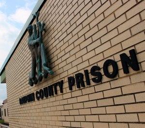 This Aug. 15, 2019 photo, shows the Dauphin County Prison in Harrisburg, Pa. (AP Photo/Michael Rubinkam, File)