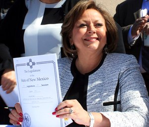 Gov. Susana Martinez holds signed legislation that expands access to the overdose antidote naloxone during a ceremony at a substance abuse treatment center for youth in Albuquerque, N.M. (AP Photo/Susan Montoya Bryan)