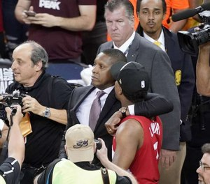In this Thursday, June 13, 2019, file photo, Toronto Raptors general manager Masai Ujiri, center left, walks with guard Kyle Lowry after the Raptors defeated the Golden State Warriors. (Photo/TNS)