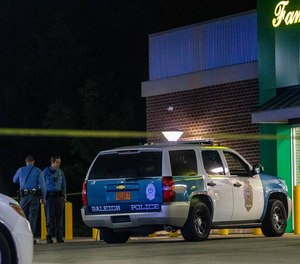 A Raleigh police officer was wounded during a gunfire exchange with a fleeing robbery suspect.
