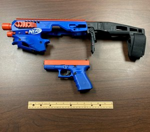 A Glock model 19 pistol painted blue and orange to look like a toy nerf gun (above).