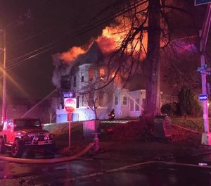 A three-alarm fire in Elizabeth, N.J., displaced 25 residents on New Year's Day. Fire officials are investigating whether fireworks ignited the blaze. (Photo/Friends of Elizabeth NJ EMS locals 87 & 309 Facebook)