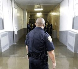 A Department of Corrections Officer walks to the Wasatch A-East block during a media tour Thursday, Feb. 26, 2015, at the Utah State Correctional Facility in Draper, Utah.