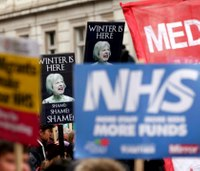 Thousands march to demand more money for UK health service