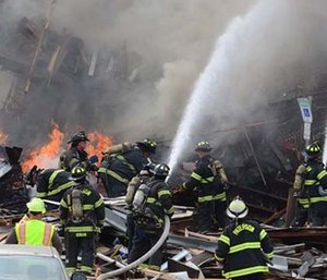 Two multifamily houses were destroyed in an explosion Tuesday morning, shortly after firefighters arrived to investigate a possible gas leak. (Tariq Zehawi/Northjersey.com/The Record via AP)