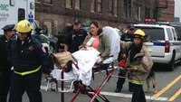 1 dead, 100-plus hurt after commuter train hits NJ station