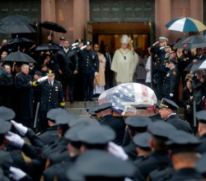 Pallbearers transport the casket of Jersey City Police Detective Joseph Seals in to St. Aeden's church for the funeral services in Jersey City, N.J.