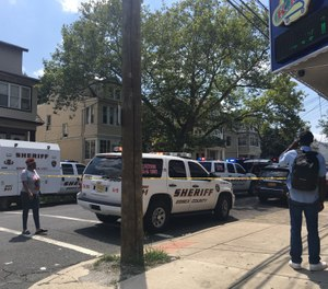 A heavy police presence along Myrtle Avenue after a police officer was shot on Thursday, Aug. 8, 2019. The officer suffered injuries not considered life-threatening. (Photo/Karen Yi   NJ Advance Media for NJ.com)