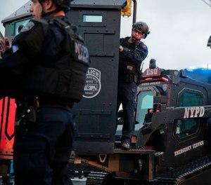 Law enforcement arrive on the scene following reports of gunfire in Jersey City, N.J. (Photo/AP/Seth Wenig)
