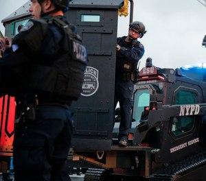 Law enforcement arrive on the scene following reports of gunfire in Jersey City, N.J.
