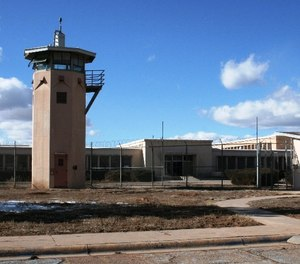Two inmates being held at the Penitentiary of New Mexico have filed a lawsuit alleging unsanitary and degrading strip searches at another state prison.
