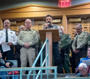 Cibola County Sheriff Tony Mace, center, flanked by several other sheriffs from around New Mexico, speaks Tuesday in opposition to a proposed red flag gun law that passed the Senate Public Affairs Committee via a party-line 4-3 vote.
