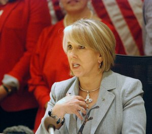 New Mexico Gov. Michelle Lujan Grisham signed a red-flag gun bill Tuesday, Feb. 25, 2020, in Santa Fe, N.M., that allows state district courts to order the temporary surrender of firearms. (Photo/TNS)