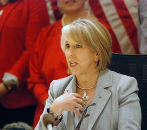 New Mexico Gov. Michelle Lujan Grisham signed a red-flag gun bill Tuesday, Feb. 25, 2020, in Santa Fe, N.M., that allows state district courts to order the temporary surrender of firearms.