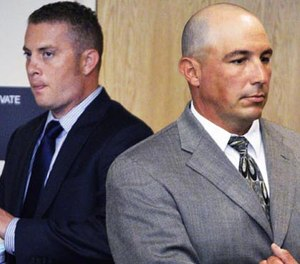 Albuquerque officer Dominique Perez, left, and former Albuquerque Detective Keith Sandy, right, stand up in court after listening to a special prosecutor tell a judge at a preliminary hearing in Albuquerque that they unlawfully shot a homeless camper who posed no threat in Albuquerque, N.M. on Monday, Aug. 3, 2015.