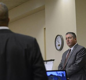 Defense attorney Sam Bregman, right, objects to a question during the trial of two former Albuquerque officers, defendants Keith Sandy, and Dominique Perez, not seen, in court on Tuesday Sept. 20, 2016 in Albuquerque, N.M.