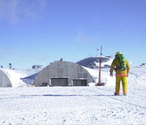 A firefighter returns to the South Pole dome after responding to a false alarm.