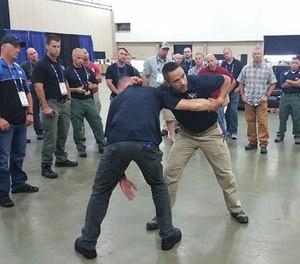 Jared Wihongi demonstrates how students must control the arm of their attacker to prevent their ability to strike again. (PoliceOne Image)