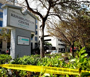 Police surround the Rehabilitation Center in Hollywood Hills, Fla.