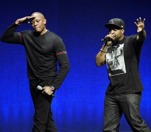 N.W.A. members Dr. Dre, left, and Ice Cube salute the crowd after speaking at a Universal Pictures presentation.