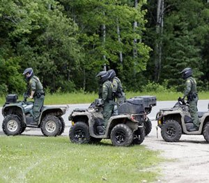 Law enforcement officers on all terrain vehicles in search for escaped prisoners in Dannemora as it continues, on Monday, June 22, 2015 (AP Image)
