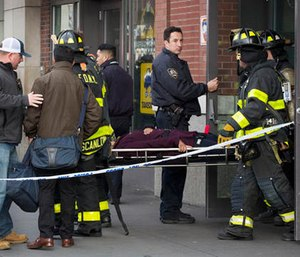 An injured passenger is taken on a gurney by firefighters from the Atlantic Terminal in the Brooklyn borough of New York after a Long Island Rail Road train hit a bumping block, Wednesday, Jan. 4, 2017. (AP Photo/Mark Lennihan)