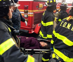 An injured passenger is taken on a gurney by firefighters from Atlantic Terminal in the Brooklyn borough of New York after a Long Island Rail Road train hit a bumping block, Wednesday, Jan. 4, 2017. (AP Photo/Mark Lennihan)