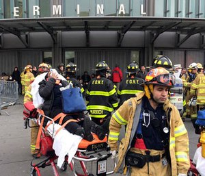 An injured passenger is taken from the Atlantic Terminal in the Brooklyn borough of New York after a Long Island Rail Road train hit a bumping block, Wednesday, Jan. 4, 2017. (AP Photo/Mark Lennihan)
