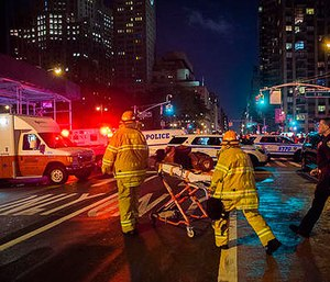 Police and firefighters work near the scene of an apparent explosion in Manhattan's Chelsea neighborhood, in New York, Saturday, Sept. 17, 2016. (AP Photo/Andres Kudacki)