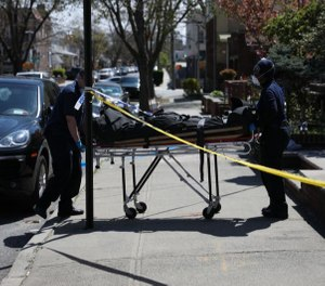 Crime Scene Unit officers at the scene of a fatal stabbing in the Dyker Heights neighborhood in Brooklyn.