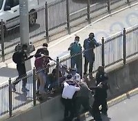 Video: NYPD chief, officers attacked by protesters on Brooklyn Bridge
