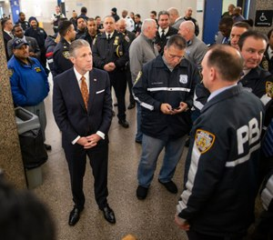 Patrolmen's Benevolent Association President Patrick J. Lynch, left, waits to go inside of courtroom to listen to the arraignment at the Bronx Criminal Court, Monday, Feb. 10, 2020, in New York. (AP Photo/Eduardo Munoz Alvarez)