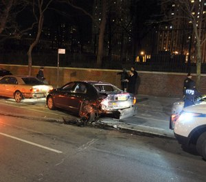 An NYPD officer's leg was fractured Tuesday night after a hit-and-run driver pinned the officer between two vehicles. (Photo/TNS)