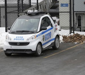 In this Feb. 12, 2015 file photo, A New York City Police Department Smart car is parked in the parking lot of Central Park's precinct in New York.