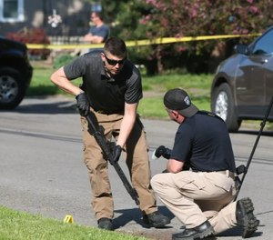 Police recover an AR-15 while searching the crime scenes where a police officer was shot along with another person in a span of two hours. (Photo/TNS)