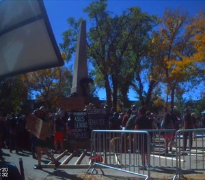 This still from bodycam video shows a crowd surrounding a war monument in Santa Fe during an Indigenous People's Day demonstration on October 12, 2020.