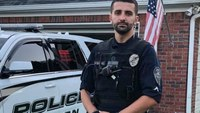 Off-duty Ga. cop lauded for saving men from burning train