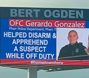 A billboard near Pharr, Texas, on September 11, 2020, honors Officer Gerard Gonzalez for going above and beyond the call of duty when he helped a police officer in another city disarm a suspect.