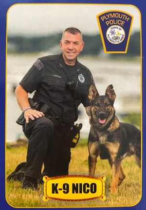 Officer Keith Larson poses with K-9 Nico.