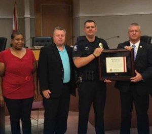 Oxford Police Officer Andrew Miller was honored by Police Chief Bill Partridge with the Life Saving Commendation.  (Photo/Oxford Police Department)