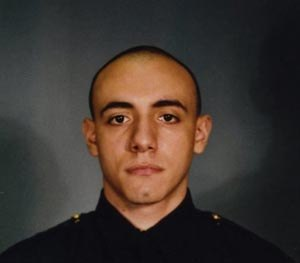 This photo provided by the Jersey City Mayor's office shows Officer Melvin Santiago. (AP Image)