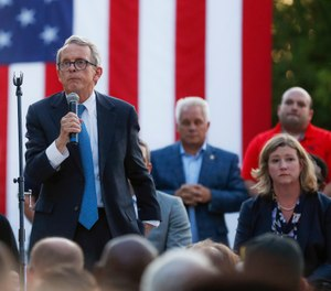 Ohio Gov. Mike DeWine, left, speaks alongside Dayton Mayor Nan Whaley, right, during a vigil at the scene of a mass shooting, Sunday, Aug. 4, 2019, in Dayton, Ohio. (AP Photo/John Minchillo)