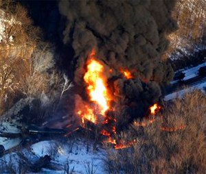 Smoke and flames erupt from the scene of a train derailment near Galena, Ill. (AP Photo/Telegraph Herald, Mike Burley)