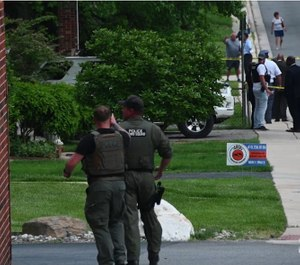 The scene of the officer-involved shooting (Photo/ The Baltimore Sun via video)