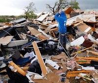 1 killed in Okla. tornados, floods; region braces for more storms